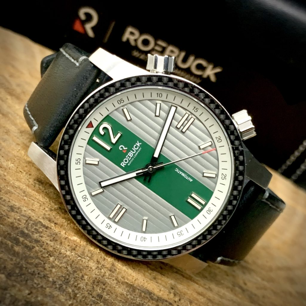 Roebuck Watch Co Division Green on Table